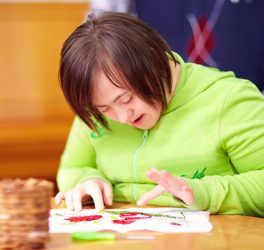 Young woman with disability engaged in craftsmanship