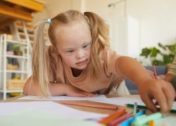 Girl with Down Syndrome in Art Class