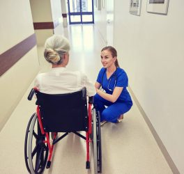 nurse with woman in wheelchair at hospital