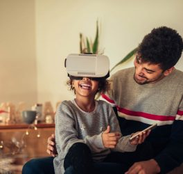 Cute young african american girl using a VR headset.