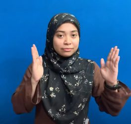 A female signing Malaysia Sign Language