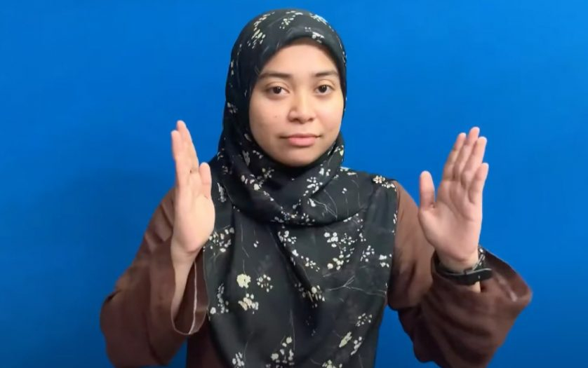 A female signing Malaysia Sign Language