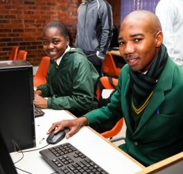 Students learning at Computer Skills Training Center in Africa