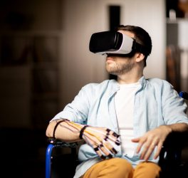 man in wheelchair traveling in virtual reality while spending time at home