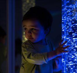 kid exploring snoezelen space