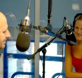 white male and female radio presenters in local radio station