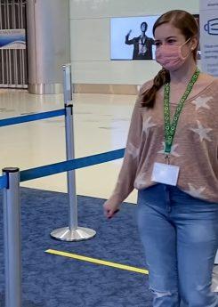 Passenger wearing Hidden Disabilities Sunflower Lanyard