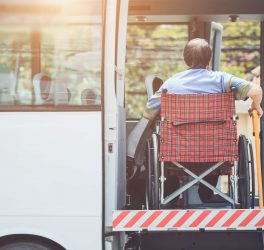 Disabled man in Wheelchair Boarding Bus