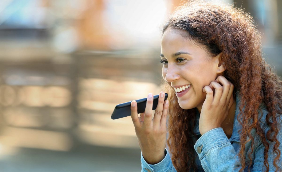 woman using voice recognition on smart phone