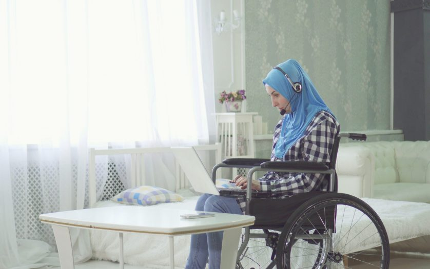 woman in wheelchair attending the meeting