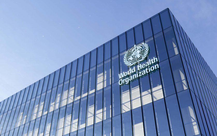 World Health Organization Signage Logo on Top of Glass Building.