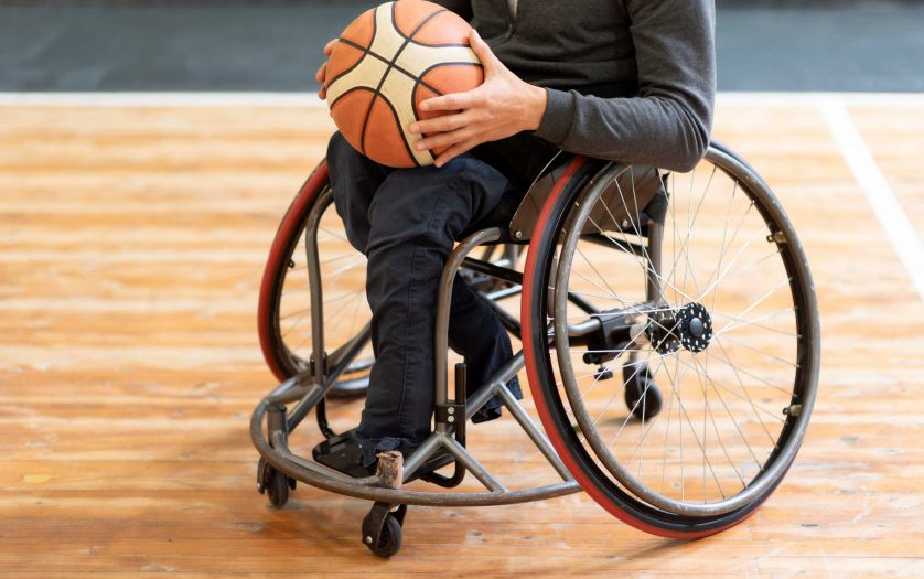 Close-up disabled man holding basketball