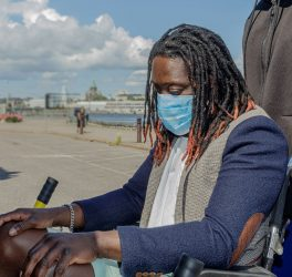 African man in wheelchair wear a medical mask to protect themselves from the coronavirus outbreak