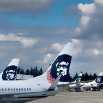 Alaska Airlines jets at the Seattle Airport waiting to be loaded with passengers and luggage.
