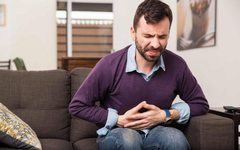 Young man with a stomach pain