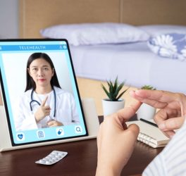 Deaf patient use video conference, make online consultation by sign language with doctor on tablet