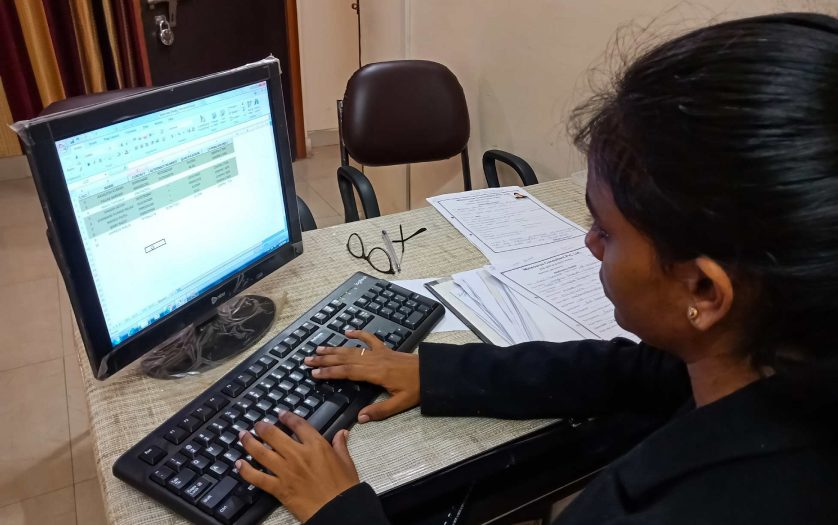 indian female office incharge working on personal computer in India