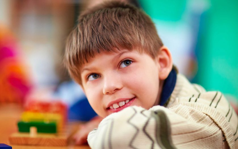 Portrait of young smiling boy with disabilities