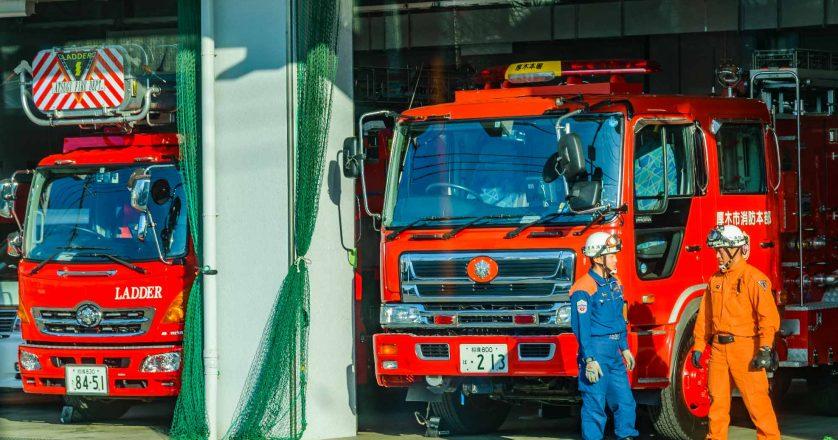 Two men talking at fire station in kanagawa prefecture, japan
