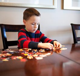 boy working on a jigsaw puzzle