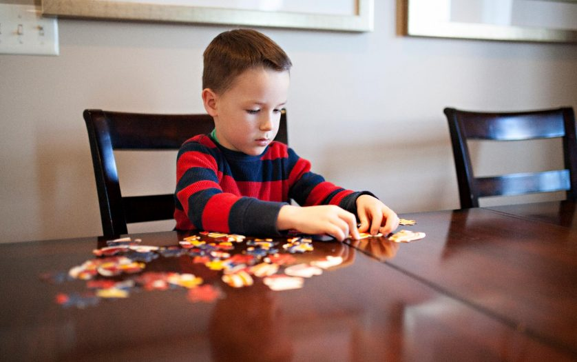 boy working on a jigsaw puzzle