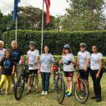 Ambassador Jacek Bazański and his family with cyclists