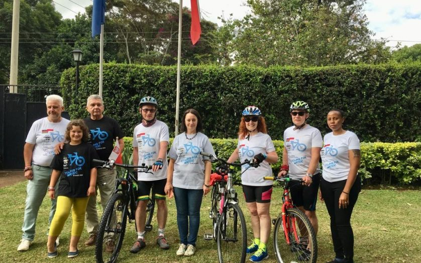 Ambassador Jacek Bazański and his family with cyclists