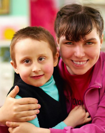 Cheerful children with disabilities in rehabilitation center