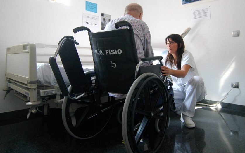 stroke perform recovery activities with the help of nurses in the recovery program at the hospital