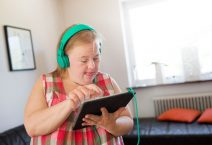 Woman with down syndrome using digital tablet