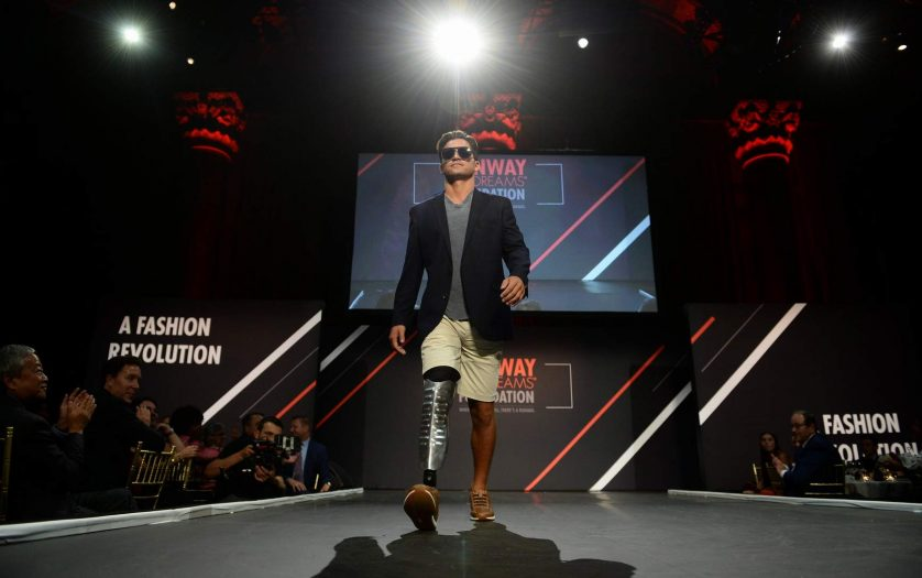 a model with disability walking at the ramp