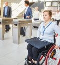 woman in a wheelchair past the security gate in the office