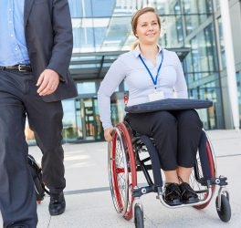 businesswoman in wheelchair on departure after meeting