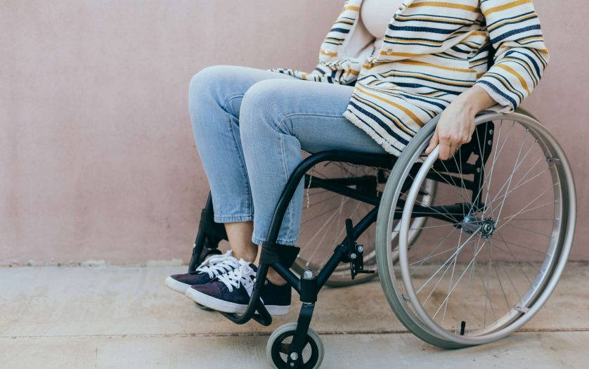 woman young woman in a wheelchair outdoors