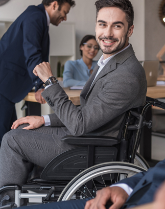 smiling disabled businessman and colleagues in office