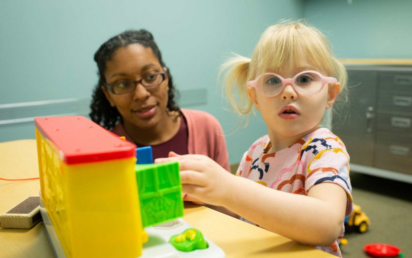 girl with autism with researcher