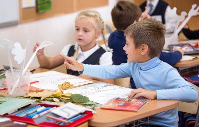 children painting in the school
