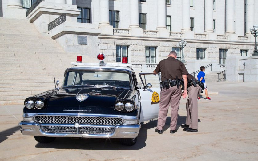 Two Policemen, Historical police car in front of the Utah State Capitol