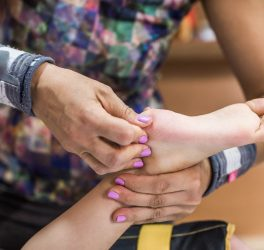 Therapist providing leg therapy