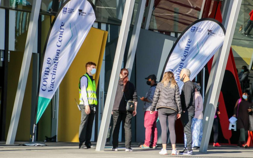 long queues as people line up to get coronavirus vaccine against covid 19 at the Melbourne exhibition convention centre in Victoria.