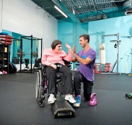 trainer with woman in wheelchair