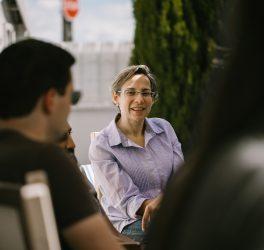 Small group of people enjoying conversation