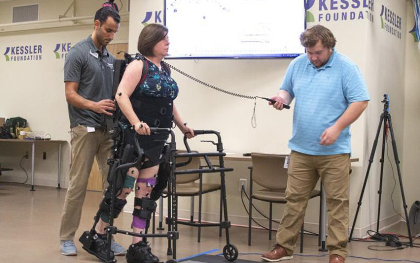 woman with Robotic exoskeleton suit walking