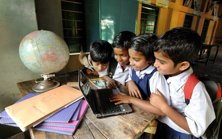 Students are learning with the help of a laptop at the rural school in West Bengal, India