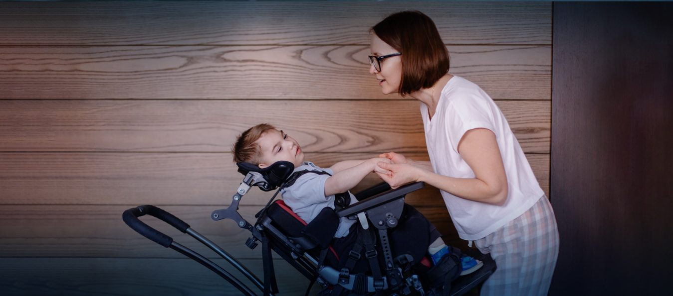 Toddler with cerebral palsy with his mother