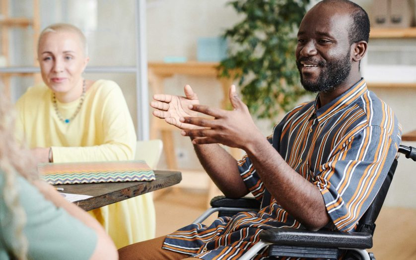 Disabled businessman talking at meeting