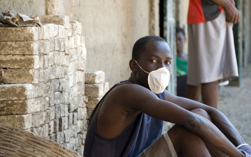 A young man wears a mask in Gonaives, Haiti.