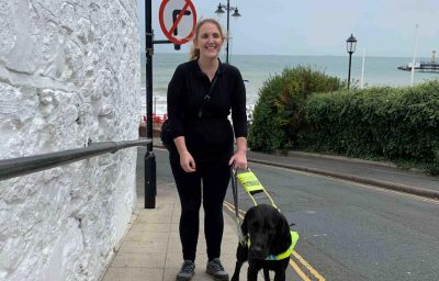 Siobhan Meade outdoor with her Guide dog
