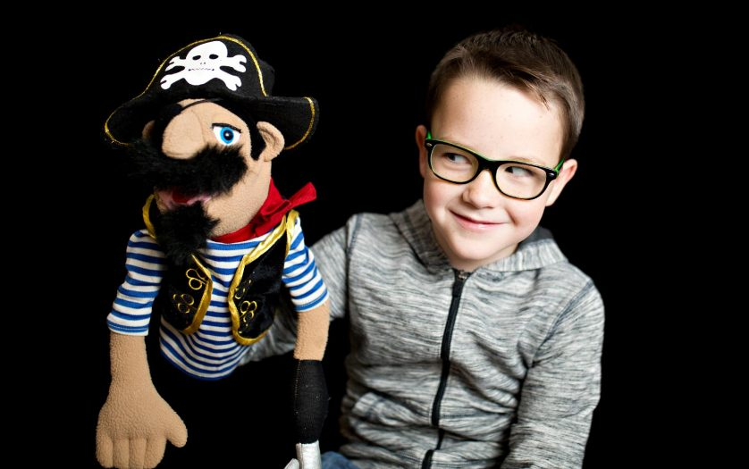 Boy with pirate puppet