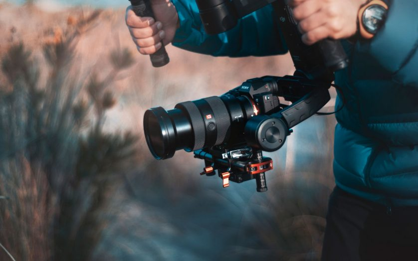 Behind the scenes of movie shooting or video production with camera equipment at outdoor